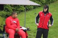 Payton love (left) Thaddeus Merten take a break between shot put